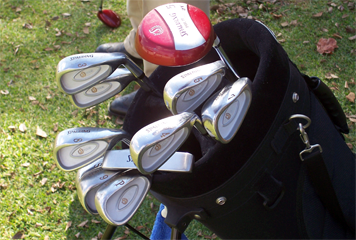 Golf bag filled with equipment